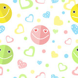 Seamless background with smiles and hearts. Royalty Free Stock Image