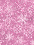 Seamless background with snowflakes. Pink seamless background with snowflakes Royalty Free Stock Photography