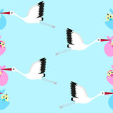 Seamless background with storks carrying newborn babies. Seamless background with storks carrying infants on a sky background, blue background Royalty Free Stock Image