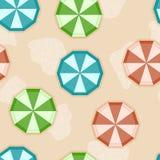 Seamless background with sun umbrellas. On sandy beach Stock Photo