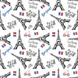 Seamless background with symbols of Paris Stock Photos