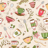 Seamless background of tea cups and spoons. Seamless background of dainty hand-drawn vector tea cups and spoons in vintage style with decorative patterns in Stock Photos