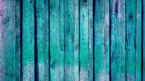 Seamless background texture of old white painted wooden lining boards wall. Vertical vintage wooden different sizes planks with spots and cracked places toned to Royalty Free Stock Photo