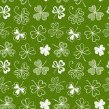 Seamless background with three leaf clover. St. Patrick's day doodle seamless background with shamrock stock illustration