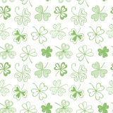 Seamless background with three leaf clover. St. Patrick's day doodle seamless background with shamrock Stock Photos