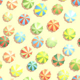 Seamless background many parasols on beach. Stock Image