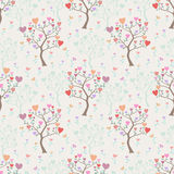 Seamless background with trees and multicolored hearts Stock Photos