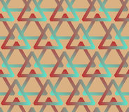 Seamless background with triangles in hipster palette Stock Images