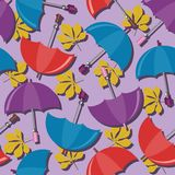 Seamless background with umbrellas and leaves Stock Images