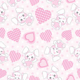 Seamless background of Valentine`s day illustration with cute pink bunny with love shape on polka dot background Stock Image