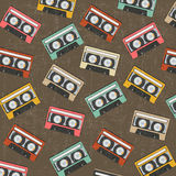 Seamless background with vintage analogue music recordable casse. Ttes,  illustration Royalty Free Stock Photo