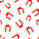 Seamless background with white gift boxes with red bows. Vector illustration. Stock Photos