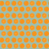 Seamless background of whole and sliced orange Royalty Free Stock Photos