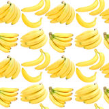 Seamless background with yellow bananas Stock Images