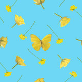 Seamless background of yellow butterfly with roses. Repeatable background of studio photographs of a butterfly and roses in yellow, isolated on sky blue Royalty Free Stock Photos