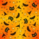 Seamless background in yellow, orange and black colours on theme of Halloween Stock Image