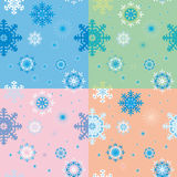 Seamless backgrounds with snowflakes Stock Photos
