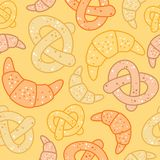 Seamless bakery pattern of croissants and pretzels Stock Photos
