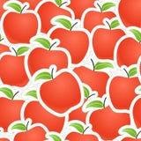 Seamless bakgrund för röda äpplen Arkivfoton