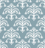 Seamless baroque pattern. White on beautiful blue background Royalty Free Stock Image