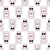 Seamless beauty pattern of perfume bottles with bows and hearts. Royalty Free Stock Image