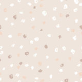 Seamless beige ink dots pattern. Vector grunge background. Vector illustration. Stock Images