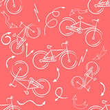 Seamless bicycles pattern. white icons on red background. Sport print. Vector Stock Images