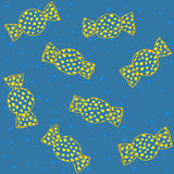Seamless birthday pattern with sweet candies. Plain  blue background with sweets. Stock Photography