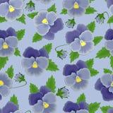seamless blåa pansies för bakgrund Arkivfoto
