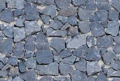 Seamless black ashlar old stone wall texture. Background Royalty Free Stock Photography