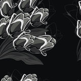 Seamless black background with black tulips. Royalty Free Stock Photo
