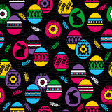 Seamless black background with color easter eggs, flowers and ra Royalty Free Stock Photography