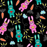Seamless black background with rabbits Stock Photos