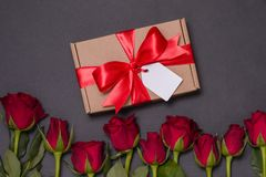 Valentines day gift ribbon bow tag, seamless black background red roses, free copy text space stock images