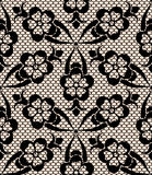 Seamless black lace pattern. On beige background Stock Image