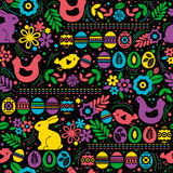 Seamless black pattern with color easter eggs, rabbit, flowers Royalty Free Stock Image