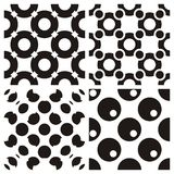 Seamless Black Wallpaper. Four different seamless circle wallpapers. The geometry gives a retro feeling. Can be used for clothes, bathrooms, kitchens, bars and Royalty Free Stock Image