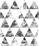 Seamless black and white background, based on handdrawn ink triangles, hand made in freehand style, laconic, imperfect, on texture Stock Image