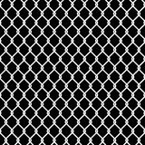 Seamless chain link fence pattern texture wallpaper. Seamless black and white chain link fence pattern background texture wallpaper Royalty Free Stock Images