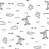 Seamless black and white kids tribal vector pattern with penguins and arrows. Royalty Free Stock Photo
