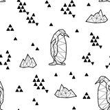 Seamless black and white kids tribal vector pattern with penguins and triangles. Stock Image