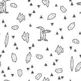 Seamless black and white kids tribal vector pattern with penguins and triangles. Stock Photos