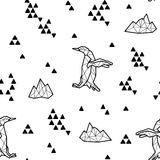 Seamless black and white kids tribal vector pattern with penguins and triangles. Stock Images