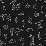 Seamless black and white kids tribal vector pattern with whales, penguins, polar bears and ice floes. Stock Images