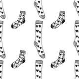 Seamless black, white pattern of doddle socks for colored book Stock Images