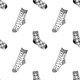Seamless black, white pattern of doddle socks for colored book Stock Image