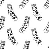 Seamless black, white pattern of doddle socks for colored book Stock Photography