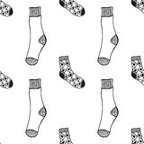 Seamless black, white pattern of doddle socks for colored book Stock Photo