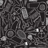 Seamless black-and-white pattern with hairdressers tools. royalty free illustration