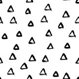 Seamless black and white vector free hand doodle texture with triangles, dry brush ink art. Royalty Free Stock Photo